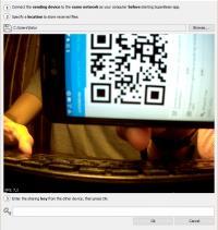 Поднесите смартфон к камере или пропишите вручную соответствующий код